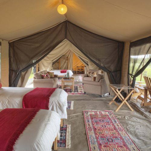 asilia_ol_pejeta_bush_camp_-_family_room_-_twin_set-up_with_view_into_lounge_and_main_bedroom